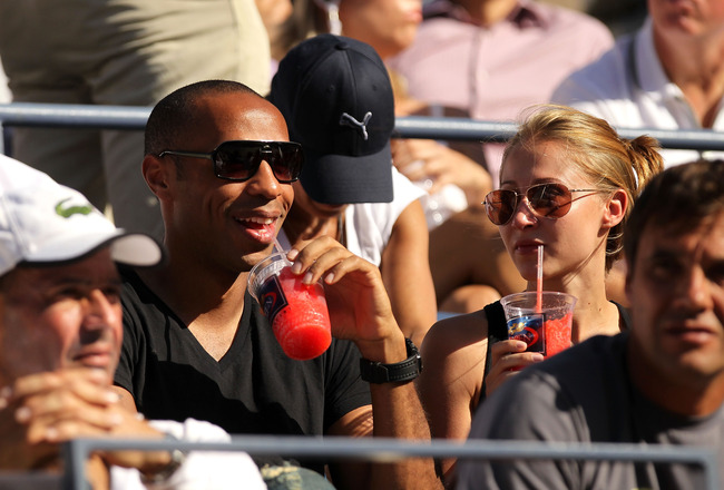 NEW YORK - SEPTEMBER 08:  French Soccer Player Thierry Henry (L) and Andrea Rajacic (R) attend day ten of the 2010 U.S. Open at the USTA Billie Jean King National Tennis Center on September 8, 2010 in the Flushing neighborhood of the Queens borough of New