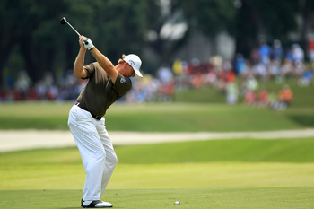 PONTE VEDRA BEACH, FL - MAY 13:  Ernie Els of South Africa hits an approach shot on the 11th hole during the second round of THE PLAYERS Championship held at THE PLAYERS Stadium course at TPC Sawgrass on May 13, 2011 in Ponte Vedra Beach, Florida.  (Photo