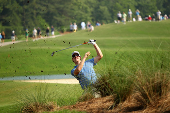 PONTE VEDRA BEACH, FL - MAY 06:  Hunter Mahan plays a shot from the rough on the 12th hole during the first round of THE PLAYERS Championship held at THE PLAYERS Stadium course at TPC Sawgrass on May 6, 2010 in Ponte Vedra Beach, Florida.  (Photo by Richa