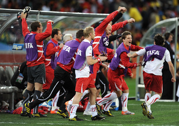 DURBAN, SOUTH AFRICA - JUNE 16:  The Switzerland team bench celebrate after victory in the 2010 FIFA World Cup South Africa Group H match between Spain and Switzerland at Durban Stadium on June 16, 2010 in Durban, South Africa.  (Photo by Jasper Juinen/Ge
