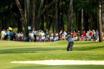 PONTE VEDRA BEACH, FL - MAY 13:  Phil Mickelson hits his aaproach on the 15th hole during the second round of THE PLAYERS Championship held at THE PLAYERS Stadium course at TPC Sawgrass on May 13, 2011 in Ponte Vedra Beach, Florida.  (Photo by Mike Ehrman
