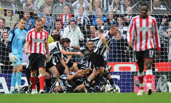 NEWCASTLE UPON TYNE, ENGLAND - OCTOBER 31:  Newcastle players celebrate the first goal by Kevin Nolan during the Barclays Premier League match between Newcastle United and Sunderland at St James' Park on October 31, 2010 in Newcastle upon Tyne, England.