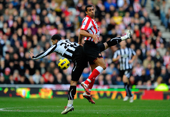 SUNDERLAND, ENGLAND - JANUARY 16:  Newcastle player Leon Best is challenged by Anton Ferdinand during the Barclays Premier League match between Sunderland and Newcastle United at Stadium of Light on January 16, 2011 in Sunderland, England.  (Photo by Stu