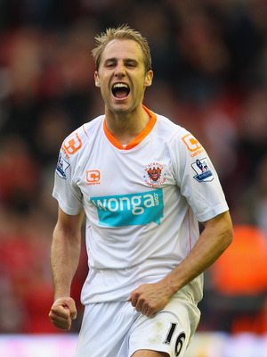 LIVERPOOL, ENGLAND - OCTOBER 03:  Luke Varney of Blackpool celebrates after victory over Liverpool the Barclays Premier League match between Liverpool and Blackpool at Anfield on October 3, 2010 in Liverpool, England.  (Photo by Alex Livesey/Getty Images)