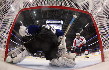 TAMPA, FL - MAY 04: Alex Ovechkin #8 of the Washington Capitals looks for a rebound from Dwayne Roloson #35 of the Tampa Bay Lightning in Game Four of the Eastern Conference Semifinals during the 2011 NHL Stanley Cup Playoffs at the St Pete Times Forum on