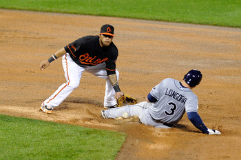 BALTIMORE, MD - MAY 06:  Evan Longoria #3 of the Tampa Bay Rays slides into second base ahead of the throw to Robert Andino #11 of the Baltimore Orioles at Oriole Park at Camden Yards on May 6, 2011 in Baltimore, Maryland.  (Photo by Greg Fiume/Getty Imag