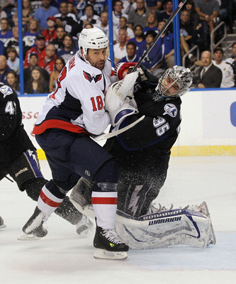 TAMPA, FL - MAY 04: Marco Sturm #18 of the Washington Capitals takes a goaltender interference penalty against Dwayne Roloson #35 of the Tampa Bay Lightning in Game Four of the Eastern Conference Semifinals during the 2011 NHL Stanley Cup Playoffs at the
