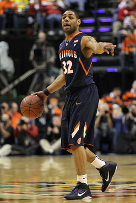INDIANAPOLIS, IN - MARCH 11:  Demetri McCamey #32 of the Illinois Fighting Illini runs the offense against the Michigan Wolverines during the quarterfinals of the 2011 Big Ten Men's Basketball Tournament at Conseco Fieldhouse on March 11, 2011 in Indianap