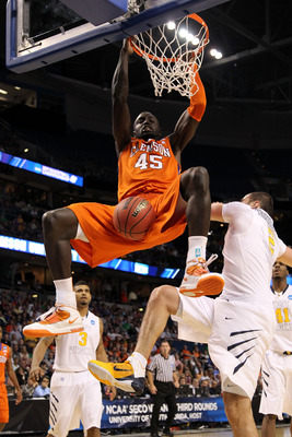 TAMPA, FL - MARCH 17:  Jerai Grant #45 of the Clemson Tigers dunks in the first half against the West Virginia Mountaineers during the second round of the 2011 NCAA men's basketball tournament at St. Pete Times Forum on March 17, 2011 in Tampa, Florida.
