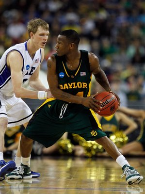 HOUSTON - MARCH 28: LaceDarius Dunn #24 of the Baylor Bears looks to pass under pressure from Kyle Singler #12 of the Duke Blue Devils during the south regional final of the 2010 NCAA men's basketball tournament at Reliant Stadium on March 28, 2010 in Hou