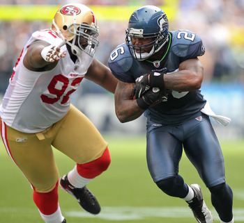 SEATTLE - SEPTEMBER 12:  Running back Michael Robinson #26 of the Seattle Seahawks rushes against Aubrayo Franklin #92 of the San Francisco 49ers during the NFL season opener at Qwest Field on September 12, 2010 in Seattle, Washington. (Photo by Otto Greu