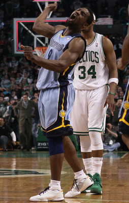 BOSTON, MA - MARCH 23:  Tony Allen #9 of the Memphis Grizzlies celebrates the win as Paul Pierce #34 of the Boston Celtics stands by on March 23, 2011 at the TD Garden in Boston, Massachusetts.  The Memphis Grizzlies defeated the Boston Celtics 90-87. NOT