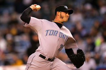 NEW YORK - APRIL 03:  Dustin McGowan #29 of the Toronto Blue Jays pitches against the New York Yankees on April 3, 2008 at Yankee Stadium in the Bronx borough of New York City.  (Photo by Chris Trotman/Getty Images)