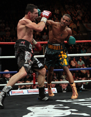 NOTTINGHAM, ENGLAND - OCTOBER 17:  Carl Froch (L) is caught by a right cross in his title against Andre Dirrell during their WBC Super Middleweight fight on October 17, 2009 at Trent FM Arena in Nottingham, England.  (Photo by John Gichigi/Getty Images)