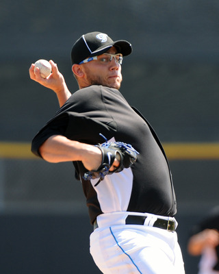 DUNEDIN, FL - FEBRUARY 26: Pitcher Brett Cecil #27 of the Toronto Blue Jays starts against the Detroit Tigers February 26, 2011 at Florida Auto Exchange Stadium in Dunedin, Florida.  (Photo by Al Messerschmidt/Getty Images)
