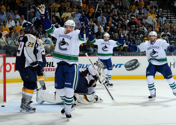 NASHVILLE, TN - MAY 09:  Daniel Sedin #22, Henrik Sedin #33, and Ryan Kesler #17of the Vancouver Canucks celebrate after a goal against Pekka Rinne #35 of the Nashville Predators in Game Six of the Western Conference Semifinals at the Bridgestone Arena on