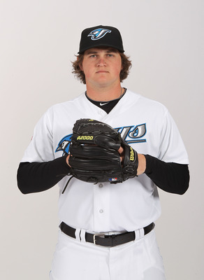 DUNEDIN, FL - FEBRUARY 20:  Chad Jenkins #64 of the Toronto Blue Jays poses during photo day at Florida Auto Exchange Stadium on February 20, 2011 in Dunedin, Florida.  (Photo by Nick Laham/Getty Images)