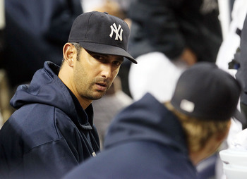 NEW YORK, NY - MAY 14:  Jorge Posada #20 of the New York Yankees looks on from the bench during the game against the Boston Red Sox on May 14, 2011 at Yankee Stadium in the Bronx borough of New York City. Posada pulled himself from the starting lineup pri