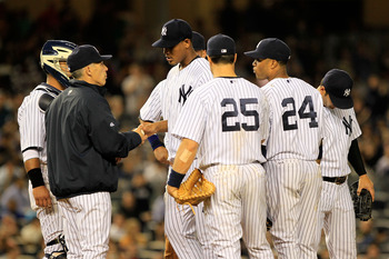 NEW YORK, NY - APRIL 26:  Pitcher Ivan Nova #47 of the New York Yankees hand the leaves the ball to Manager Joe Girardi as he leaves the game in the seventh inning against the Chicago White Sox at Yankee Stadium on April 26, 2011 in the Bronx borough of N