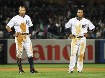 NEW YORK, NY - MAY 13:  Alex Rodriguez #13 and Robinson Cano #24 of the New York Yankees are left on base at the end of the the eigth inning against the Boston Red Sox on May 13, 2011 at Yankee Stadium in the Bronx borough of New York City.  (Photo by Al