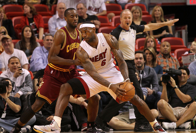 MIAMI, FL - JANUARY 31:  LeBron James #6 of the Miami Heat posts up Daniel Gibson #1 of the Cleveland Cavaliers during a game at American Airlines Arena on January 31, 2011 in Miami, Florida. NOTE TO USER: User expressly acknowledges and agrees that, by d