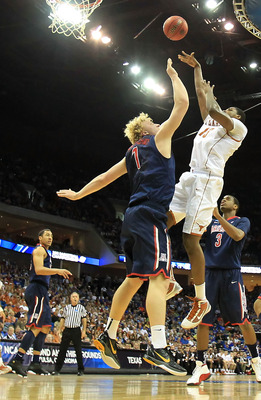 TULSA, OK - MARCH 20:  Tristan Thompson #13 of the Texas Longhorns takes a shot as Kyryl Natyazhko #1 of the Arizona Wildcats defends during the third round of the 2011 NCAA men's basketball tournament at BOK Center on March 20, 2011 in Tulsa, Oklahoma.