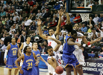DENVER, CO - MARCH 19:  Kenneth Faried #35 of the Morehead State Eagles loses control of the ball while going to the basket against Josh Duinker #11, Justin Harper #32 and Francis-Cedric Martel #15 of the Richmond Spiders during the third round of the 201