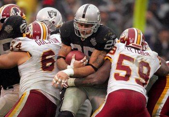 OAKLAND, CA - DECEMBER 13:  Justin Fargas #25 of the Oakland Raiders runs with the ball during their game against the Washington Redskins at Oakland-Alameda County Coliseum on December 13, 2009 in Oakland, California.  (Photo by Ezra Shaw/Getty Images)