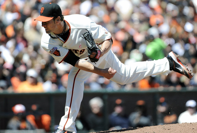 SAN FRANCISCO, CA - MAY 8: Ryan Vogelsong #32 of the San Francisco Giants pitches against Colorado Rockies during a MLB baseball game at AT&T Park May 8, 2011 in San Francisco, California.  The Giants won the game 3-1. (Photo by Thearon W. Henderson/Getty