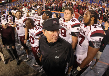 GAINESVILLE, FL - NOVEMBER 13:  South Carolina Gamecocks head coach Steve Spurrier greets his players after winning a game against the Florida Gators at Ben Hill Griffin Stadium on November 13, 2010 in Gainesville, Florida. The Gamecocks beat the Gators 3