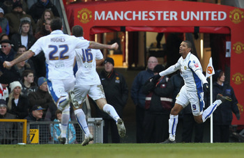 MANCHESTER, ENGLAND - JANUARY 03:  Jermaine Beckford (R) of Leeds United celebrates scoring the opening goal during the FA Cup sponsored by E.ON 3rd Round match between Manchester United and Leeds United at Old Trafford on January 3, 2010 in Manchester, E