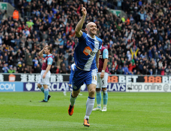 WIGAN, ENGLAND - MAY 15:  Conor Sammon of Wigan Athletic celebrates scoring his team's second goal during the Barclays Premier League match between Wigan Athletic and West Ham United at the DW Stadium on May 15, 2011 in Wigan, England.  (Photo by Chris Br