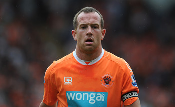 BLACKPOOL, ENGLAND - MAY 14:  Charlie Adam of Blackpool looks on during the Barclays Premier League match between Blackpool and Bolton Wanderers at Bloomfield Road on May 14, 2011 in Blackpool, England.  (Photo by Chris Brunskill/Getty Images)