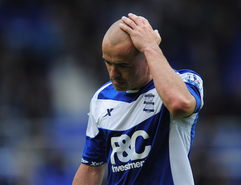 BIRMINGHAM, ENGLAND - MAY 15:  Birmingham City captain Stephen Carr is dejected at the final whistle at the end of the Barclays Premier League match between Birmingham City and Fulham at St. Andrews on May 15, 2011 in Birmingham, England.  (Photo by Shaun