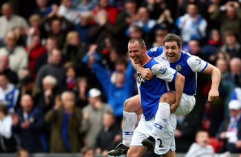 BLACKBURN, UNITED KINGDOM - APRIL 04:  Andre Ooijer of Blackburn Rovers celebrates his team's winning goal with David Dunn during the Barclays Premier League match between Blackburn Rovers and Tottenham Hotspur at Ewood Park on April 4, 2009 in Blackburn,