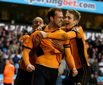 WOLVERHAMPTON, ENGLAND - MARCH 06:  Steven Fletcher (C) of Wolves celebrates scoring the equalising goal with teammates Karl Henry (L) and Kevin Doyle (R) during the Barclays Premier League match between Wolverhampton Wanderers and Tottenham Hotspur at Mo