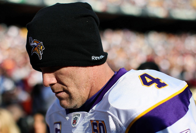 LANDOVER, MD - NOVEMBER 28:  Brett Favre #4 of the Minnesota Vikings walks off the field at the end of the first half against the Washington Redskins at FedExField November 28, 2010 in Landover, Maryland. The Vikings won the game 17-13.  (Photo by Win McN