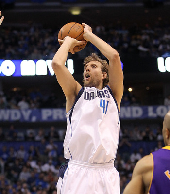 DALLAS, TX - MAY 08:  Forward Dirk Nowitzki #41 of the Dallas Mavericks takes a shot against Pau Gasol #16 of the Los Angeles Lakers in Game Four of the Western Conference Semifinals during the 2011 NBA Playoffs on May 8, 2011 at American Airlines Center