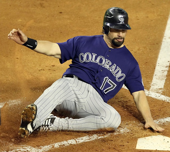 PHOENIX, AZ - MAY 04:  Todd Helton #17 of the Colorado Rockies slides in to score a fourth inning run against the Arizona Diamondbacks during the Major League Baseball game at Chase Field on May 4, 2011 in Phoenix, Arizona.  (Photo by Christian Petersen/G