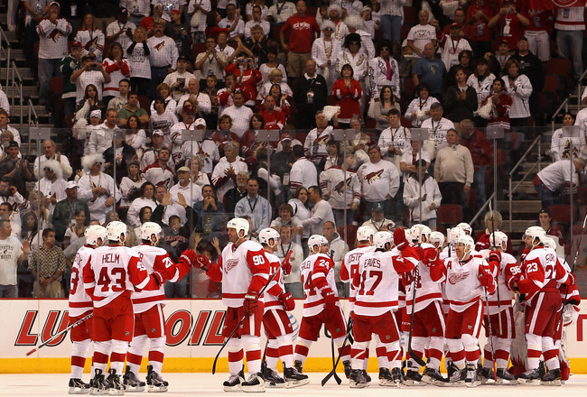 GLENDALE, AZ - APRIL 20:  Mike Modano #90 of the Detroit Red Wings celebrates with teammates after defeating the Phoenix Coyotes in Game Four of the Western Conference Quarterfinals during the 2011 NHL Stanley Cup Playoffs at Jobing.com Arena on April 20,
