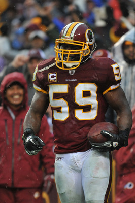 LANDOVER, MD - DECEMBER 12:  London Fletcher #59 of the Washington Redskins celebrates a goalline fumble recovery against the Tampa Bay Buccaneers  at FedExField on December 12, 2010 in Landover, Maryland. The Buccaneers defeated the Redskins 17-16. (Phot