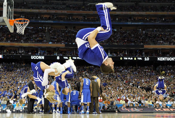 HOUSTON, TX - APRIL 02:  Cheerleaders from the Kentucky Wildcats performs during the National Semifinal game of the 2011 NCAA Division I Men's Basketball Championship at Reliant Stadium on April 2, 2011 in Houston, Texas.  (Photo by Streeter Lecka/Getty I