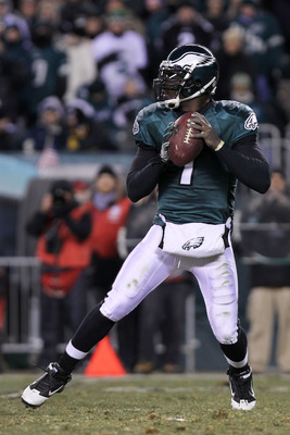 PHILADELPHIA, PA - JANUARY 09:  Michael Vick #7 of the Philadelphia Eagles drops back against the Green Bay Packers during the 2011 NFC wild card playoff game at Lincoln Financial Field on January 9, 2011 in Philadelphia, Pennsylvania.  (Photo by Nick Lah