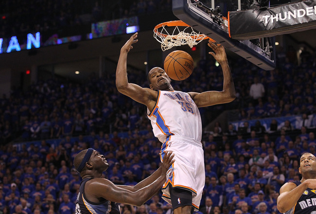 OKLAHOMA CITY, OK - MAY 15:  Forward Kevin Durant #35 of the Oklahoma City Thunder gets the slam dunk against Zach Randolph #50 of the Memphis Grizzlies in Game Seven of the Western Conference Semifinals in the 2011 NBA Playoffs on May 15, 2011 at Oklahom