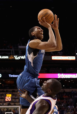 PHOENIX - DECEMBER 15:  Wesley Johnson #4 of the Minnesota Timberwolves drives to the basket over Grant Hill #13 of the Phoenix Suns during the NBA game at US Airways Center on December 15, 2010 in Phoenix, Arizona. The Suns defeated the Timberwolves 128-