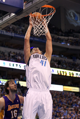 DALLAS, TX - MAY 08:  Forward Dirk Nowitzki #41 of the Dallas Mavericks gets the slam dunk against Pau Gasol #16 of the Los Angeles Lakers in Game Four of the Western Conference Semifinals during the 2011 NBA Playoffs on May 8, 2011 at American Airlines C