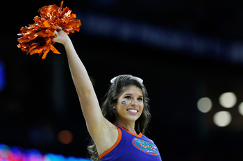 NEW ORLEANS, LA - MARCH 26:  An Florida Gators cheerleader performs during their game against the Butler Bulldogs in the Southeast regional final of the 2011 NCAA men's basketball tournament at New Orleans Arena on March 26, 2011 in New Orleans, Louisiana