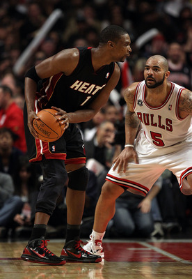 CHICAGO, IL - FEBRUARY 24: Chris Bosh #1 of the Miami Heat looks to moves against Carlos Boozer #5 of the Chicago Bulls at the United Center on February 24, 2011 in Chicago, Illinois. The Bulls defeated the Heat 93-89. NOTE TO USER: User expressly acknowl