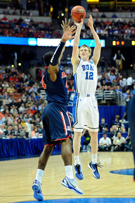 ANAHEIM, CA - MARCH 24:  Kyle Singler #12 of the Duke Blue Devils shoot the ball over Solomon Hill #44 of the Arizona Wildcats during the west regional semifinal of the 2011 NCAA men's basketball tournament at the Honda Center on March 24, 2011 in Anaheim