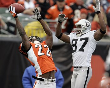 CINCINNATI, OH - DECEMBER 10:  Jonathan Joseph #22 of the Cincinnati Bengals almost intercepts a pass intended for Alvis Whitted #87 of the Oakland Raiders during the second quarter on December 10, 2006 at Paul Brown Stadium in Cincinnati, Ohio.  The Beng